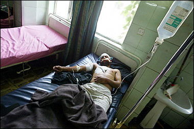 man_lies_on_hospital_bed